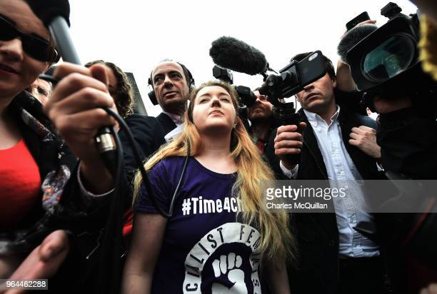 Eleanor Crossey Malone takes an abortion pill as abortion rights campaign group ROSA Reproductive Rights Against Oppression Sexism and Austerity...