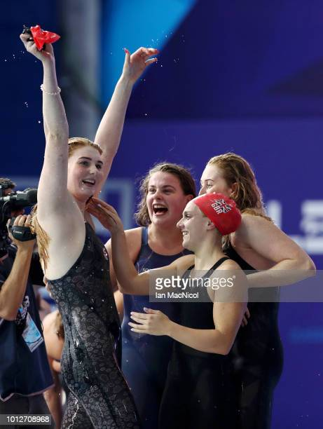 Eleanor Faulkner, Kathryn Greenslade, Holly Hibbott and Freya Anderson of Great Britain celebrate winning gold in the Women's 4 x 200m Freestyle...