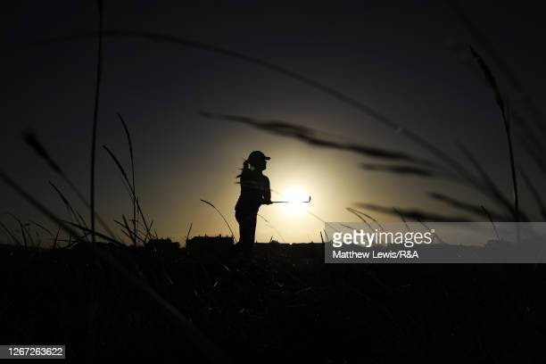 Eleanor Givens of England plays her second shot on the 2nd hole out of the rough AlenaSharp of Canada the sun rises during Day One of the 2020 AIG...