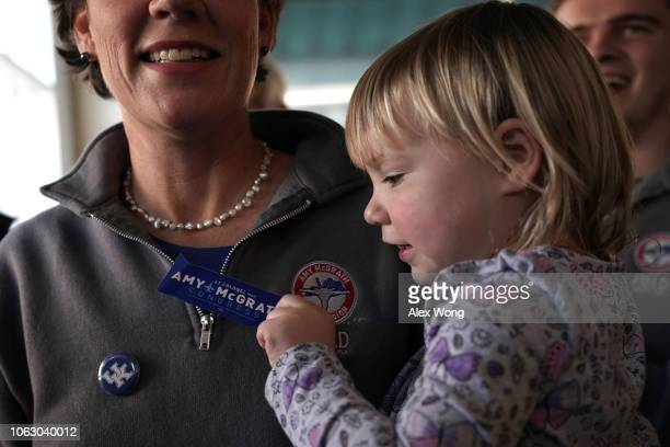Eleanor Henderson daughter of Democratic US House of Representatives candidate for Kentucky's Sixth Congressional District Amy McGrath put a campaign...