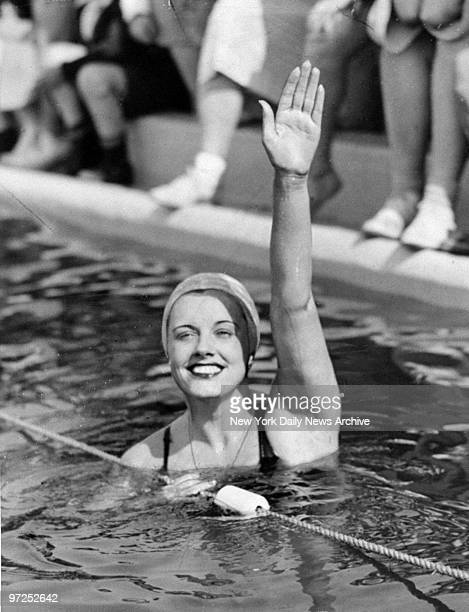 Eleanor Holm Jarrett greets her fans after winning the 200meter backstroke in the Met AAU meet at Manhattan Beach Brooklyn