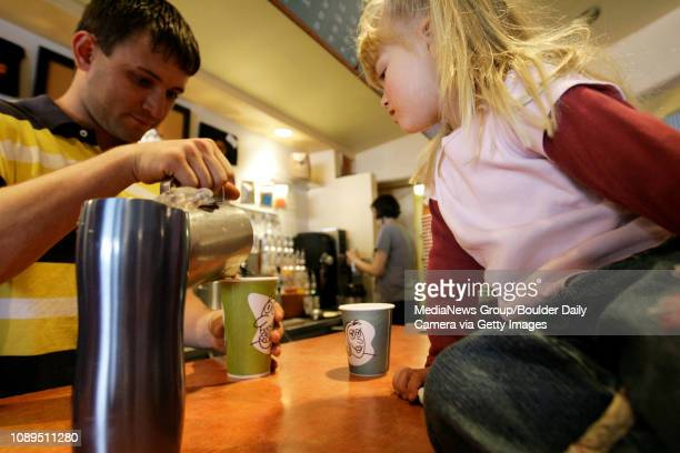 Eleanor Malcolm of Boulder watches Beau Burris a barista at Vics Coffee on north Broadway in Boulder pour her mother Janine's drink on April 23 2008...