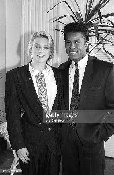 Eleanor Mondale and Jermaine Jackson pose for a portrait at the Calhoun Beach Club in Minneapolis Minnesota on Novermber 13 1989