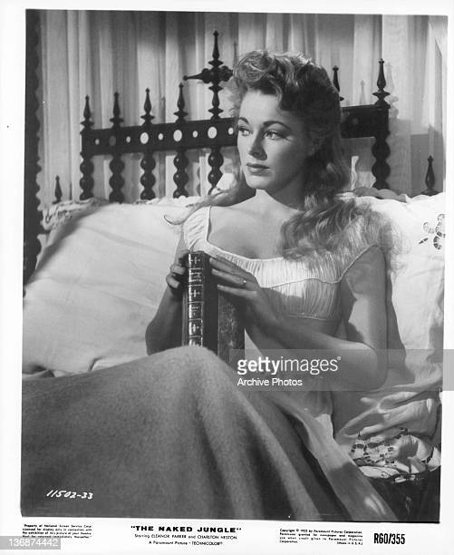Eleanor Parker in bed with a book in a scene from the film 'The Naked Jungle' 1953