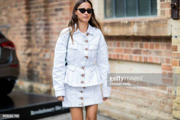 Eleanor Pendleton wearing white denim jacket and mini skirt during MercedesBenz Fashion Week Resort 19 Collections at Carriageworks on May 16 2018 in...
