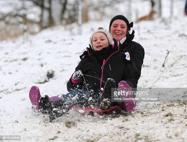 Eleanor Penfold and Chloe Jones sledge down Chapel Hill in Pocklington East Yorkshire after overnight snowfall
