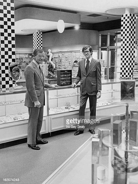 SEP 29 1972 SEP 30 1972 OCT 1 1972 Eleanor Pomie of Joseph Magnin gives final examination to a display in the department store firm's outlet in...