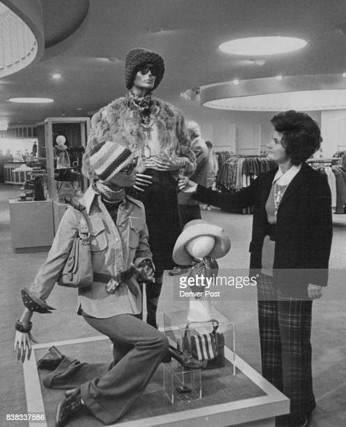 Eleanor Pomie of Joseph Magnin gives final examination to a display in the department store firm's outlet in Cinderella City Shopping Center in...