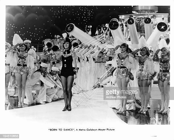 Eleanor Powell gives a salute with many other performers in a scene from the film 'Born To Dance' 1936