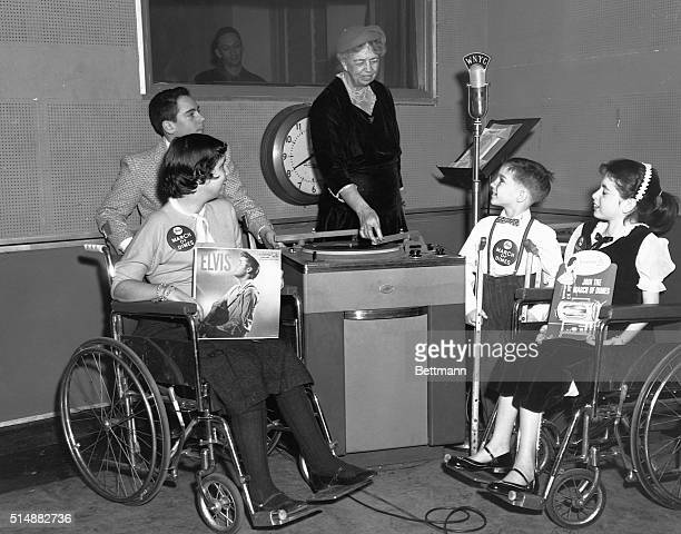 Eleanor Roosevelt acts as a disk jockey for children afflicted with polio. The purpose of the broadcast was to generate interest in a series of...