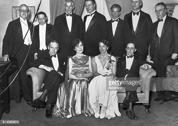 Eleanor Roosevelt attends a dinner of authors Seated left to right are Gene Buck Julia Peterkin Roosevelt and Claude G Bowers Standing are Dr George...
