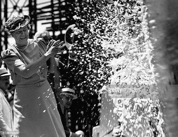 Eleanor Roosevelt breaks a bottle of champagne on the bow of the SS America at its launch
