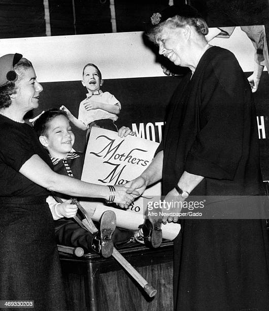 Eleanor Roosevelt former First Lady and wife of former President Franklin D Roosevelt signs up as a volunteer for the Mother's March on Polio 1950