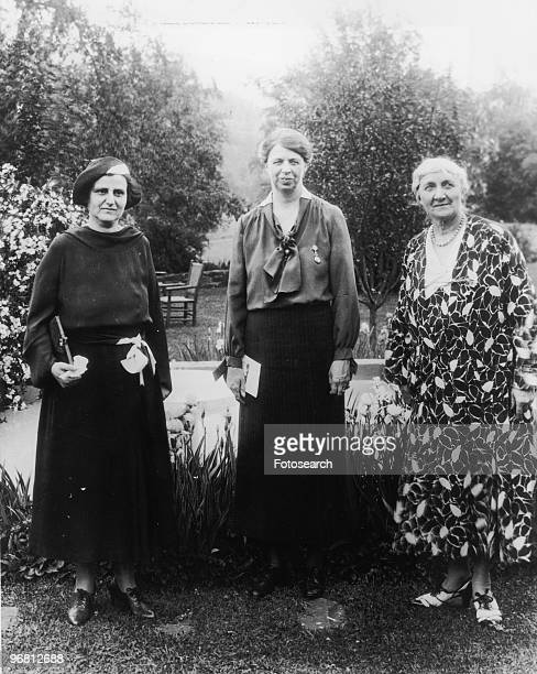 Eleanor Roosevelt Henry Morgenthau Jr and Jane Addams stand in garden circa 1929