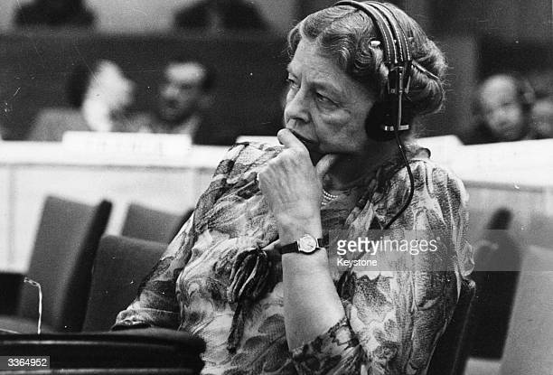 Eleanor Roosevelt humanitarian the widow of American President Franklin Delano Roosevelt and representative to the United Nations listening through...