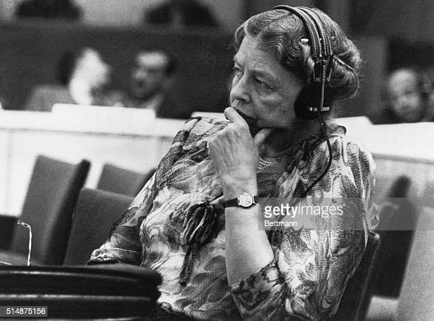 Eleanor Roosevelt sits with headphones during a speech at the United Nations