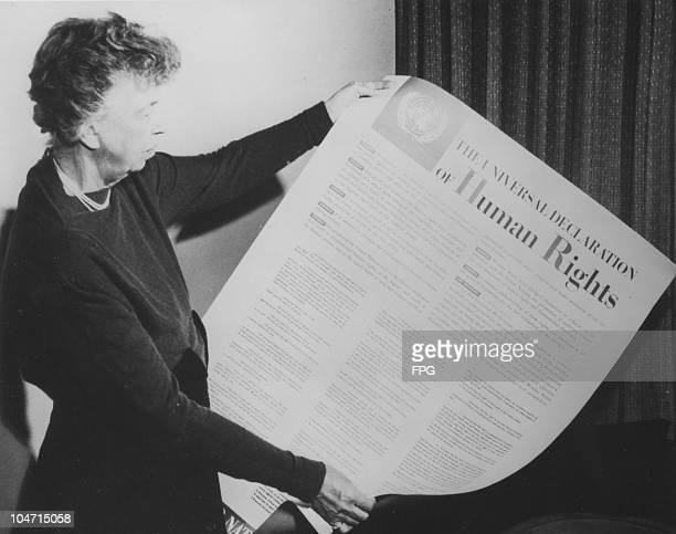 Eleanor Roosevelt wife of Franklin Delano Roosevelt and First Lady of the United States from 1933 to 1945 holds up the Universal Declaration of Human...