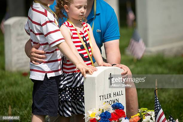 Eleanor Sitkiewicz of Richmond Virginia stands with her brother Henry and father Greg at the grave of Tyler Hall Brown a college friend of her father...