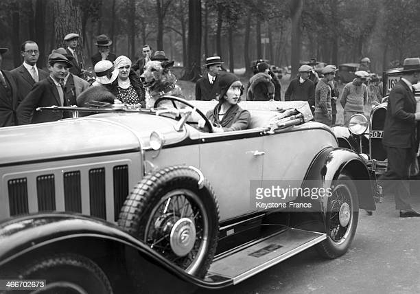 Eleanor Smith young Aviation heroin driving a car during an All times Fashion Review in July 1929 in New York City