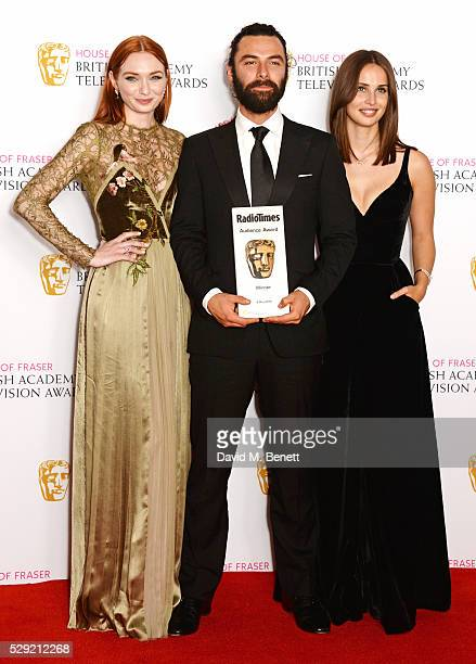 Eleanor Tomlinson Aidan Turner and Heida Reed accepting the Radio Times BAFTA Audience Award for Poldark pose in the winners room at the House Of...