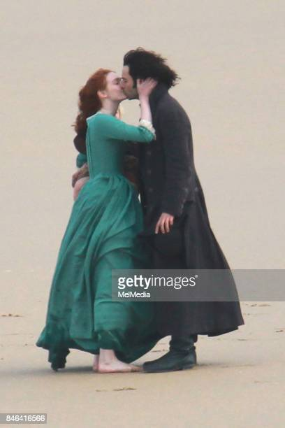 Eleanor Tomlinson and Aidan Turner seen filming the fourth series of Poldark on the Cornish coastline on September 12 2017 in Cornwall