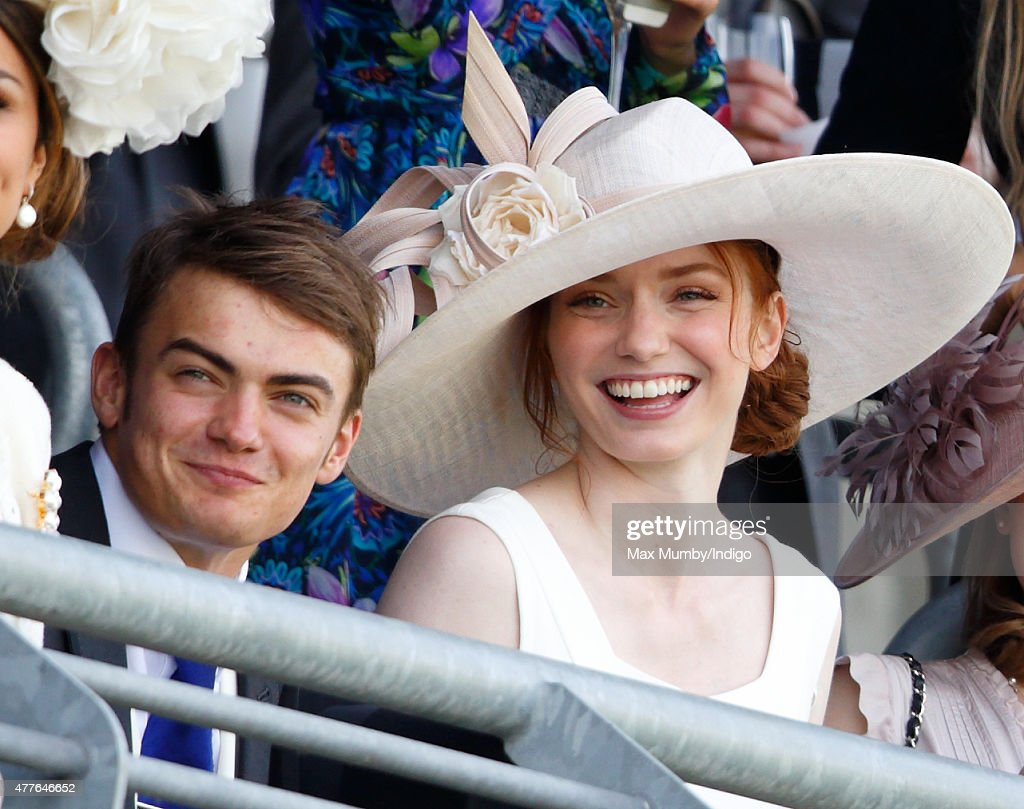 Eleanor Tomlinson and Ben Atkinson watch the racing as they attend day 3, Ladies Day, of Royal Ascot at Ascot Racecourse on June 18, 2015 in Ascot, England.