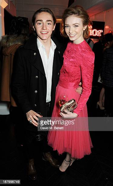 Eleanor Tomlinson and brother Ross Tomlinson attend the opening of the Dior Beauty Boutique in Covent Garden on November 14 2013 in London England