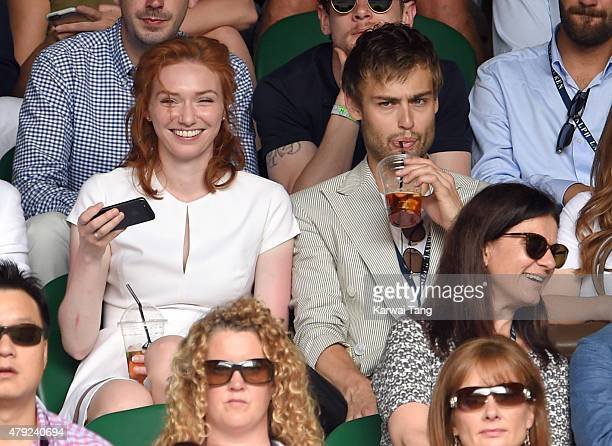Eleanor Tomlinson and Douglas Booth attend the Sam Querry v Roger Federer match on day four of the Wimbledon Tennis Championships at Wimbledon on...