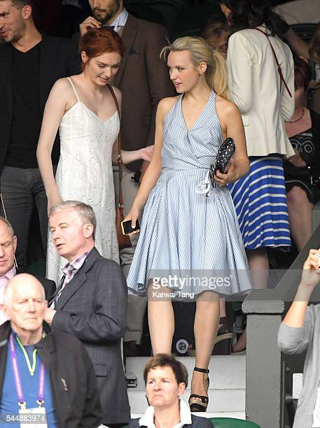 Eleanor Tomlinson and Emily Berrington attend day eight of the Wimbledon Tennis Championships at Wimbledon on July 04 2016 in London England