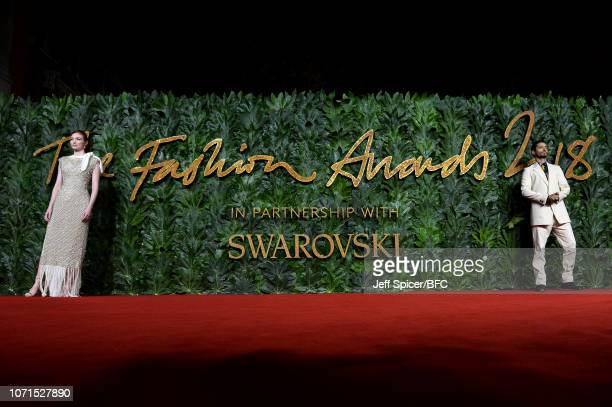 Eleanor Tomlinson and Riz Ahmed arrive at The Fashion Awards 2018 In Partnership With Swarovski at Royal Albert Hall on December 10 2018 in London...