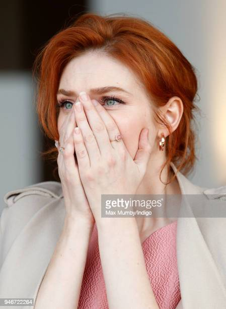 Eleanor Tomlinson watches the racing as she attends day three 'Grand National Day' of The Randox Health Grand National Festival at Aintree Racecourse...