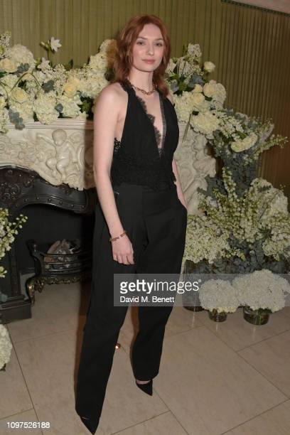 Eleanor Tomlinson wearing Tiffany Co attends the British Vogue and Tiffany Co Celebrate Fashion and Film Party at Annabel's on February 10 2019 in...