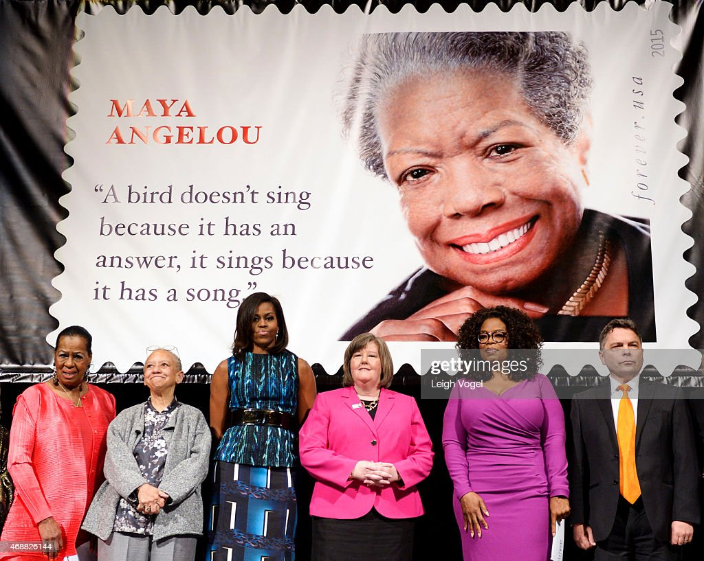 Eleanor W. Traylor, Nikki Giovanni, Michelle Obama, Megan J. Brennan, Oprah Winfrey and Ross Rossin stand on stage during the Maya Angelou Forever Stamp Dedication at Warner Theatre on April 7, 2015 in Washington, DC.