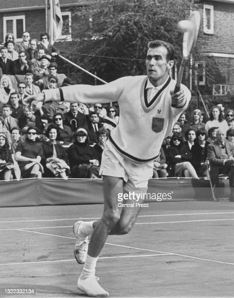 Eleazar Davidman of Israel makes makes a forehand return to Roger Taylor of Great Britain during their Men's Singles First Round European Zone Davis...