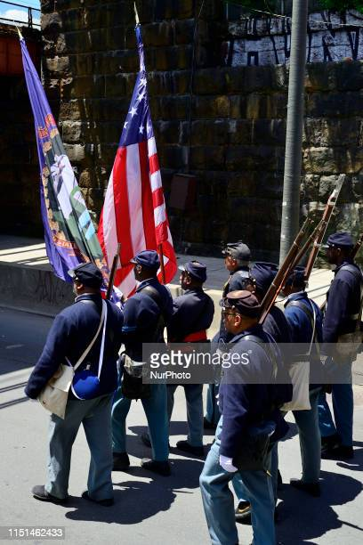 Elected officials community leaders youth and drum and marching bands take part in the second annual Juneteenth Parade in Philadelphia PA on June 22...