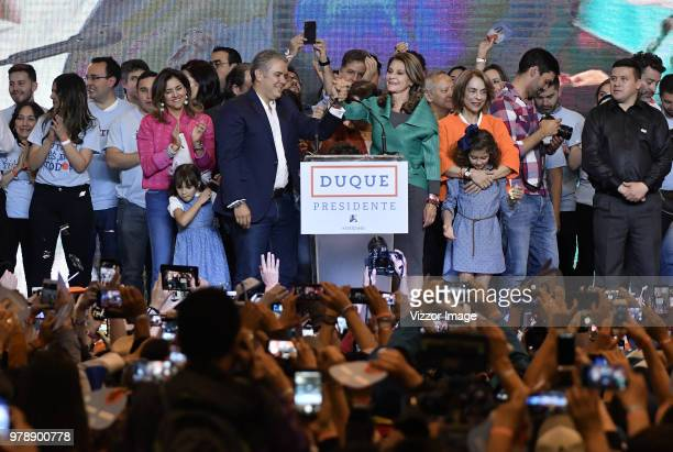 Elected President of Colombia Ivan Duque gestures with elected vicepresident Martha Lucia Ramirez after winning the presidential ballotage against...