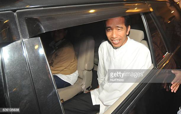 Elected president of Indonesia Joko Widodo answering reporters' questions when he returned to his hometown in Surakarta Central Java Indonesia on...