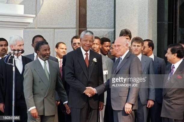 Elected South African President Nelson Mandela and former President and Deputy President Frederick De Klerk shake hands as Second Deputy President...