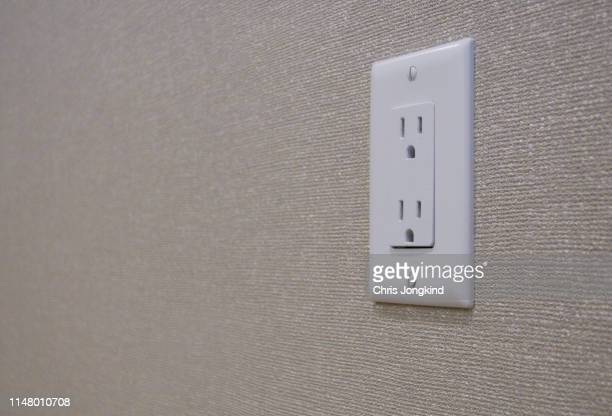 electical outlet on wall - electrical outlet stock pictures, royalty-free photos & images