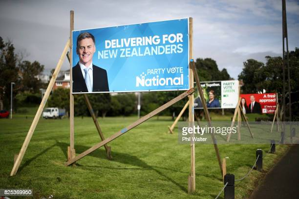 Election billboards for National Green and Labour are pictured on August 2 2017 in Auckland New Zealand Jacinda Ardern was elected unopposed as new...