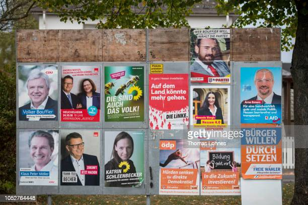 Election billboards that shows lead candidates of the Hesse state elections like Volker Bouffier lead candidate for the German Christian Democrats...