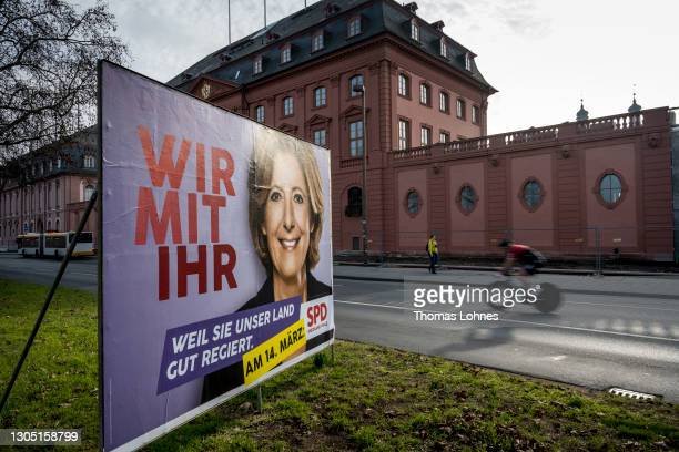 Election campaign billboard featuring lead candidate of the SPD, the prime minister of Rhineland-Palastinate Malu Dreyer pictured on March 03, 2021...