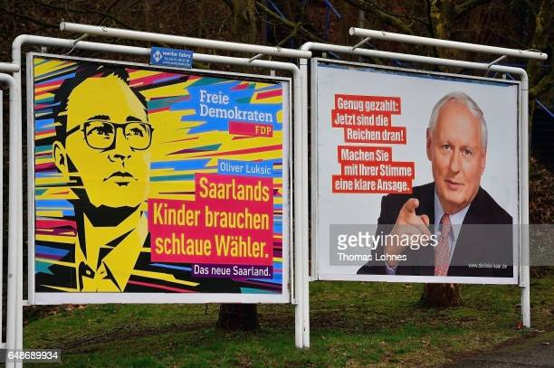 Election campaign billboards for the top candidates Oliver Luksic and Oskar Lafontaine pictured on March 6 2017 in Saarbruecken Germany Saarland...