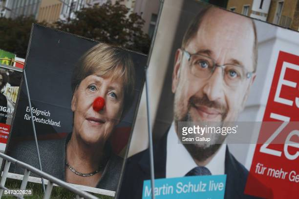 Election campaign billboards that show German Social Democrat chancellor candidate Martin Schulz and German Chancellor and Christian Democrat Angela...