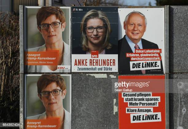 Election campaign posters hang on March 15 2017 in Schwalbach Germany Schwalbach is in the industrial heartland of Saarland the small German state...