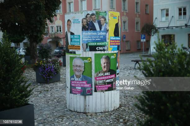 Election campaign posters including of the Bavarian Social Union and thw German Greens Party hang on September 20 2018 in Tittmoning Germany Bavaria...