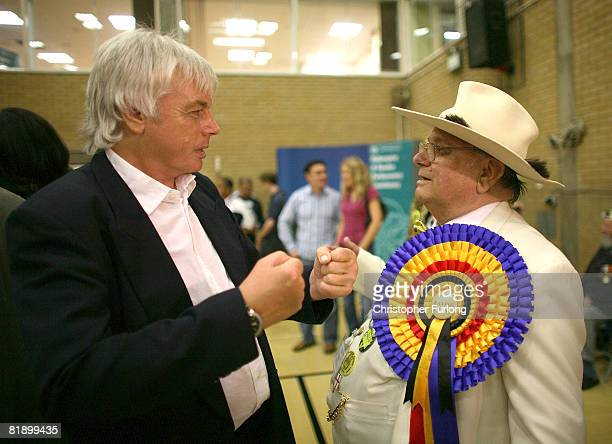 Election candidate David Icke chats with Official Monster Raving Loony Party supporter Alan Hope during the count at the Haltemprice and Howden...