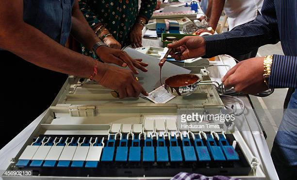 Election Commission staff memabers seal the Electronic Voting Machines at 181Mahim assembly constituency election office at Antonio Da Silva School...