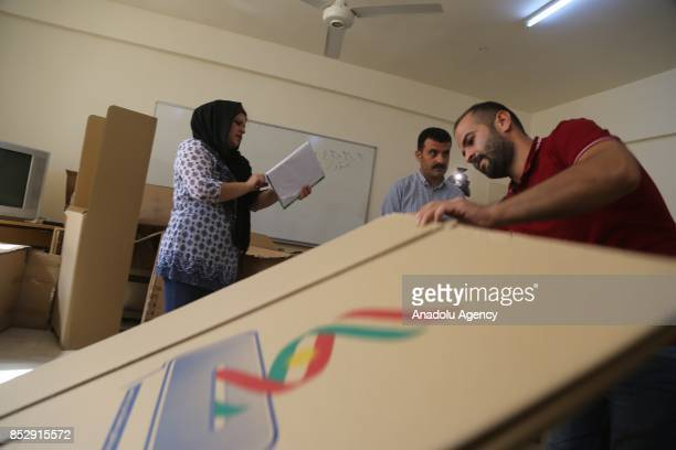 Election committee workers place ballot boxes at the Barzani Namir high school polling station ahead of the upcoming Kurdish Regional Government...