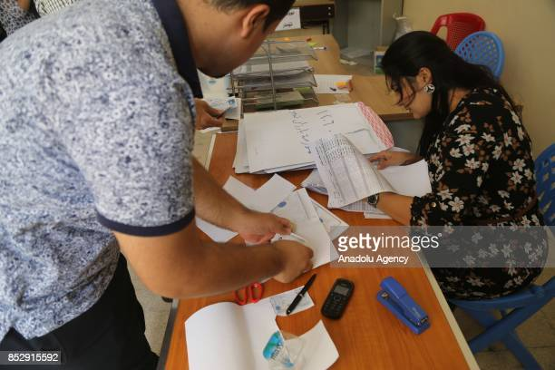 Election committee workers prepare ballots at the Barzani Namir high school polling station ahead of the upcoming Kurdish Regional Government...